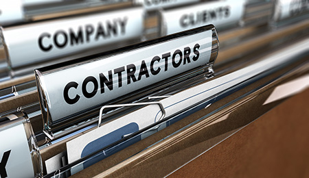 Close up on a file tab with the word contractors focus on the main word and blur effect. Concept image for illustration of contractors or subcontractors company database.