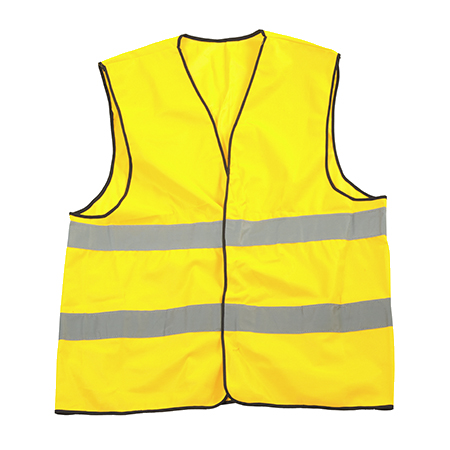 Yellow reflective safety jacket isolated over a white background.